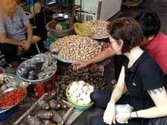 Chef M buying taro at the street market in Sa Dec Vietnam