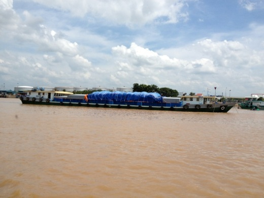 large rice barge going upriver in Vietnam