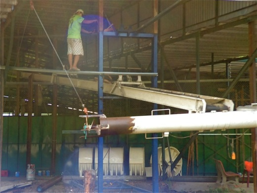 Vietnam rice factory using an auger to lift rice from a barge