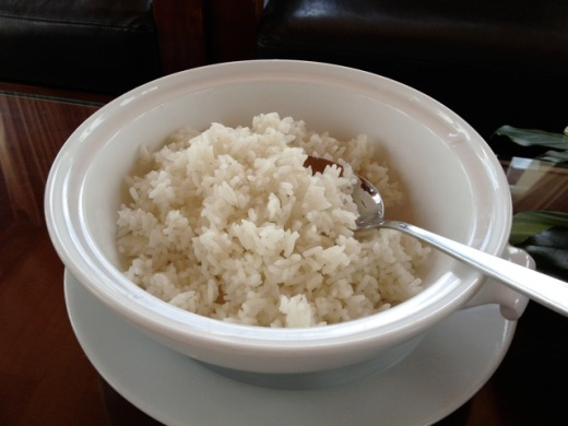 Vietnamese rice, steamed and served in a white porcelain dish