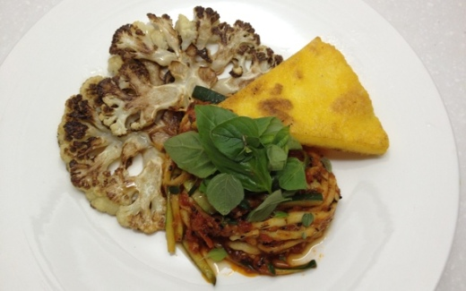 zucchini noodles in tomato sauce served with cauliflower steaks and crispy polenta